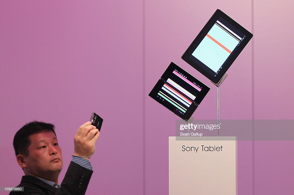 A visitor looks at Sony tablet PCs at the Sony stand at the IFA 2011 consumer electonics and appliances trade fair on the first day of the fair's official opening on September 2, 2011 in Berlin, Germany. The IFA 2011 will be open to the public from September 2-7.