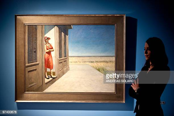 ROUX A visitor looks at ' South Carolina Morning ' painting by US artist Edward Hopper is displayed on February 24 2010 during the first opening of...