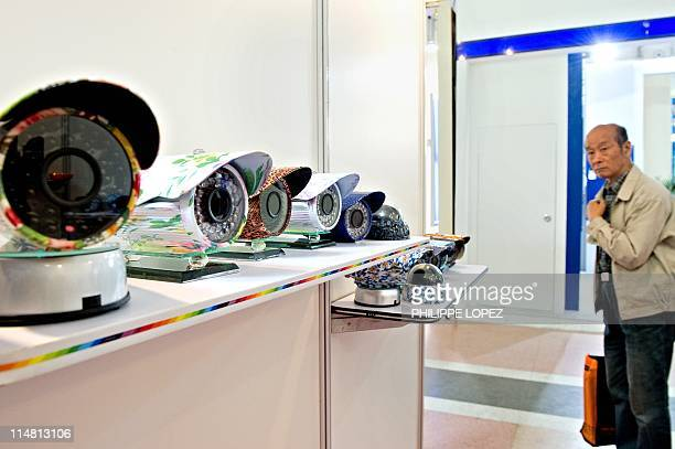 A visitor looks at surveillance cameras displayed at the international exhibition on public safety and security in Shanghai on April 27 2011...