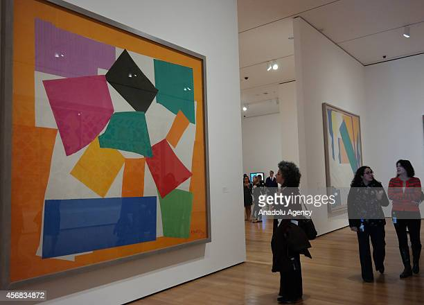 Visitor looks at the art work 'L'Escargot ' by the French artist Henri Matisse during the Private View of upcoming exhibition entitled 'Henri Matisse...
