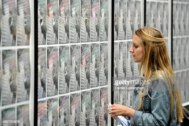 A visitor looks at the artwork '1974 Diary' by Ian Breakwell in the Unlimited section of Art Basel on June 16 2014 in Basel Switzerland Art Basel one...