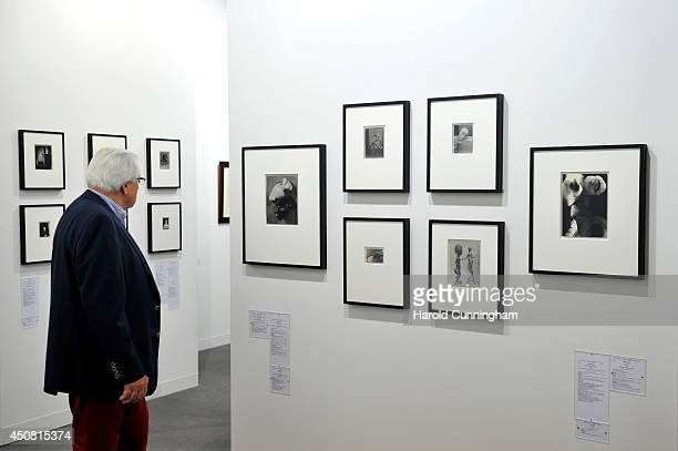 A visitor looks at the artwork by Man Ray in the gallery section of Art Basel on June 18 2014 in Basel Switzerland Art Basel one of the most...