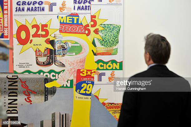 A visitor looks at the artwork 'Interieur' by Albert Oehlen in the gallery section of Art Basel on June 17 2014 in Basel Switzerland Art Basel one of...