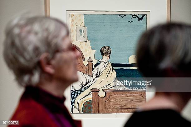 A visitor looks at 'The boy and the moon' painting by US artist Edward Hopper on February 24 2010 during the first opening of exhibition running from...