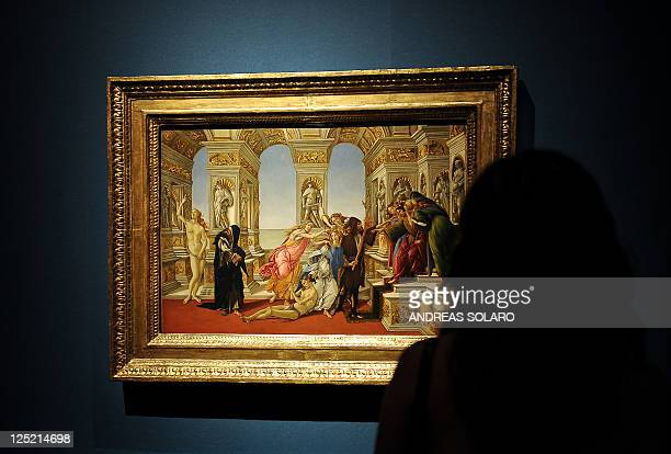 A visitor looks at 'The calumny of Apelles' by Italian Renaissance painter Sandro Botticelli as part of the exhibition 'Money and Beauty bankers...