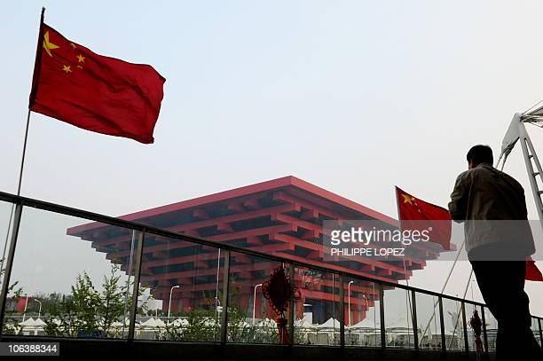 A visitor looks at the Chinese pavilion at the site of the World Expo 2010 in Shanghai on October 31 2010 Shanghai on October 31 shuts the gates to...