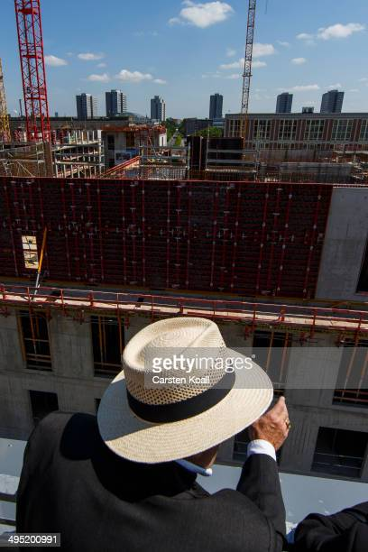 A visitor looks at the construction site of the Berlin City Palace in the city center on June 1 2014 in Berlin Germany The Berliner Schloss was the...