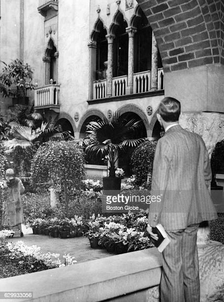 A visitor looks at the courtyard at the Isabella Stewart Gardner Museum in Boston on April 6 1932