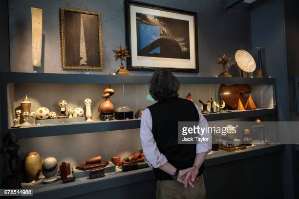A visitor looks at the exhibits from 'Every Object Tells a Story' at 5 Cromwell Place on May 4 2017 in London England British art dealer Oliver Hoare...
