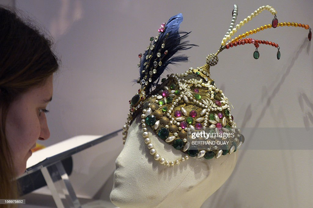 A visitor looks at the headdress that Russian dancer and choreographer Ida Rubinstein wore in the ballet Scheherazade in 1910, displayed during the exhibition entitled 'Les Mille et une Nuits' (The thousand and one nights) at the Arab World Institute (IMA) on November 26, 2012 in Paris. The event runs until April 28, 2013.