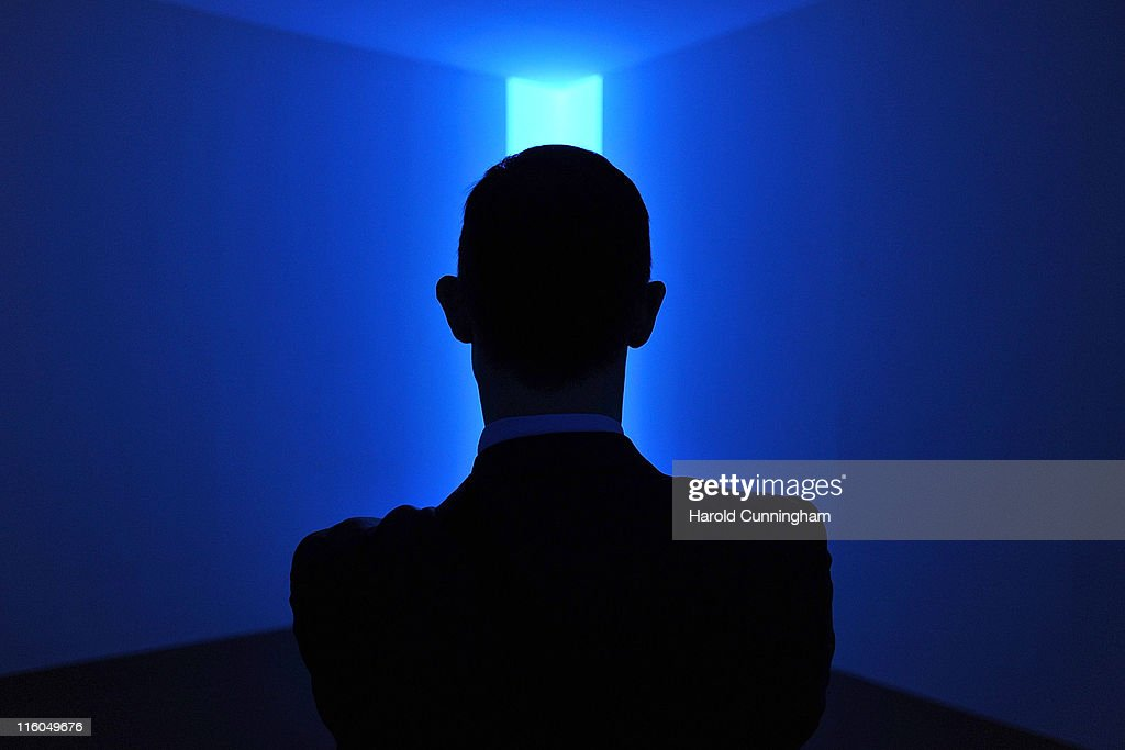 A visitor looks at the James Turrell Joecar Blue 1968 artwork on June 14 2011 in Basel Switzerland 300 art galleries selected by the fair will...