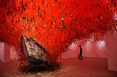 A visitor looks at 'The Key in the Hand' a piece of art by Japanese artist Chiharu Shiota presented at Japan's pavilion during the 56th International...