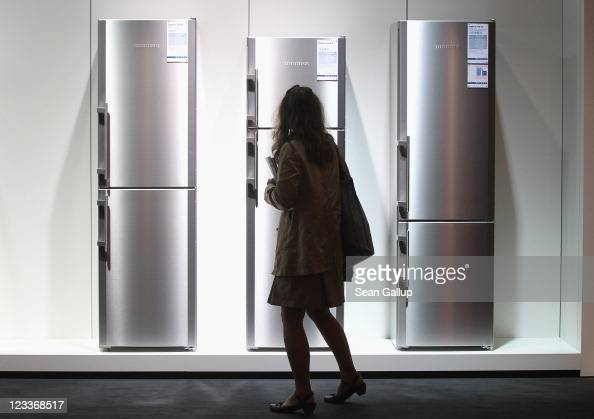 A visitor looks at the latest generation of refrigerators at the Liebherr stand at the IFA 2011 consumer electonics and appliances trade fair on the...