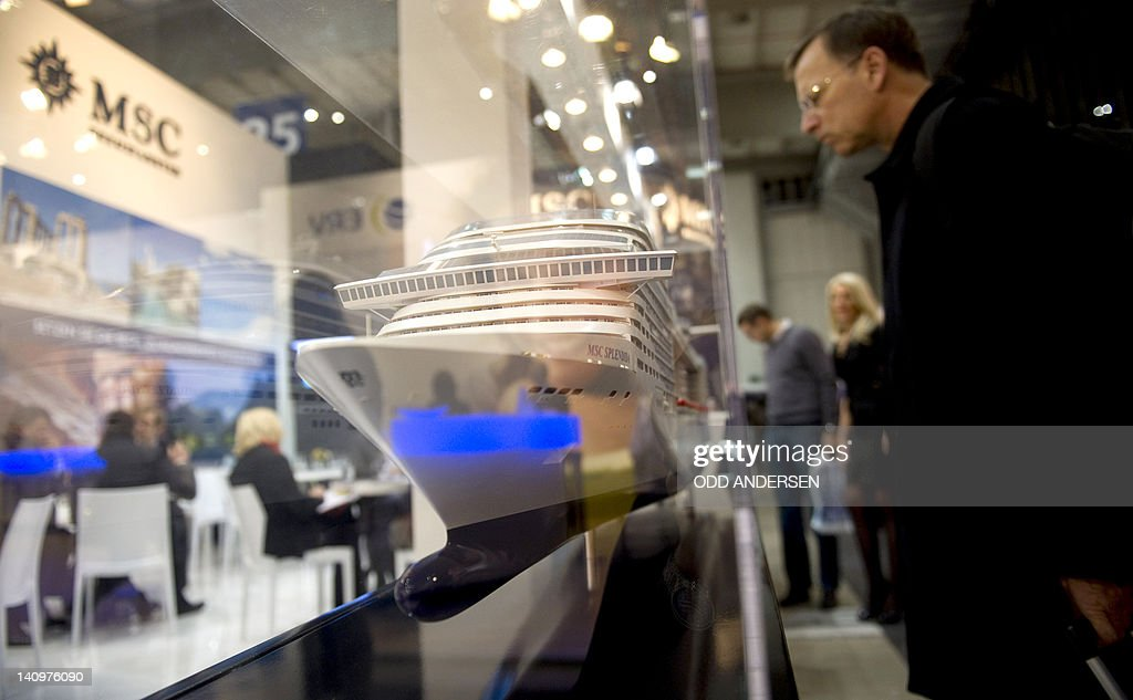 A visitor looks at the model of a cruise ship at the MSC cruising company booth at the ITB international tourism fair in Berlin on March 9, 2012. The ITB travel trade show, with 10,644 exhibitors from 187 countries, is due to run until March 11.