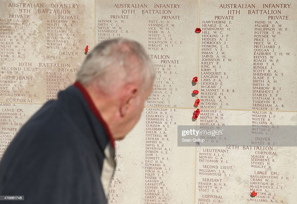 A visitor looks at the names of Australian soldiers killed during the Gallipoli Campaign at the Lone Pine monument ahead of commemoration ceremonies...