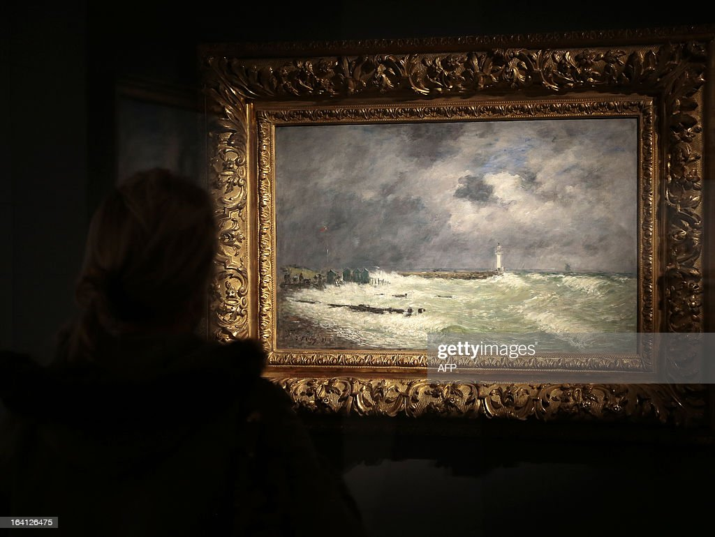 A visitor looks at the painting, 'coup de vent devant Frascati (Le Havres)' on March 20, 2013 at the Jacquemart-Andre museum during the inaugural visit to the French painter Eugene Boudin's (1824 - 1898) exhibition running from March 22 to July 22, 2013.