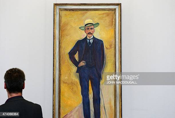 A visitor looks at the painting 'Harry Graf Kessler ' by Norwegian Painter Edvard Munch during a press preview of the ImEx exhibition at Berlin's...