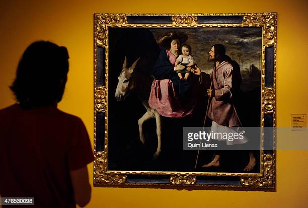 A visitor looks at the painting 'Huida a Egipto' by Francisco de Zurbaran during the opening for the press of the exhibition 'Zurbaran a new...