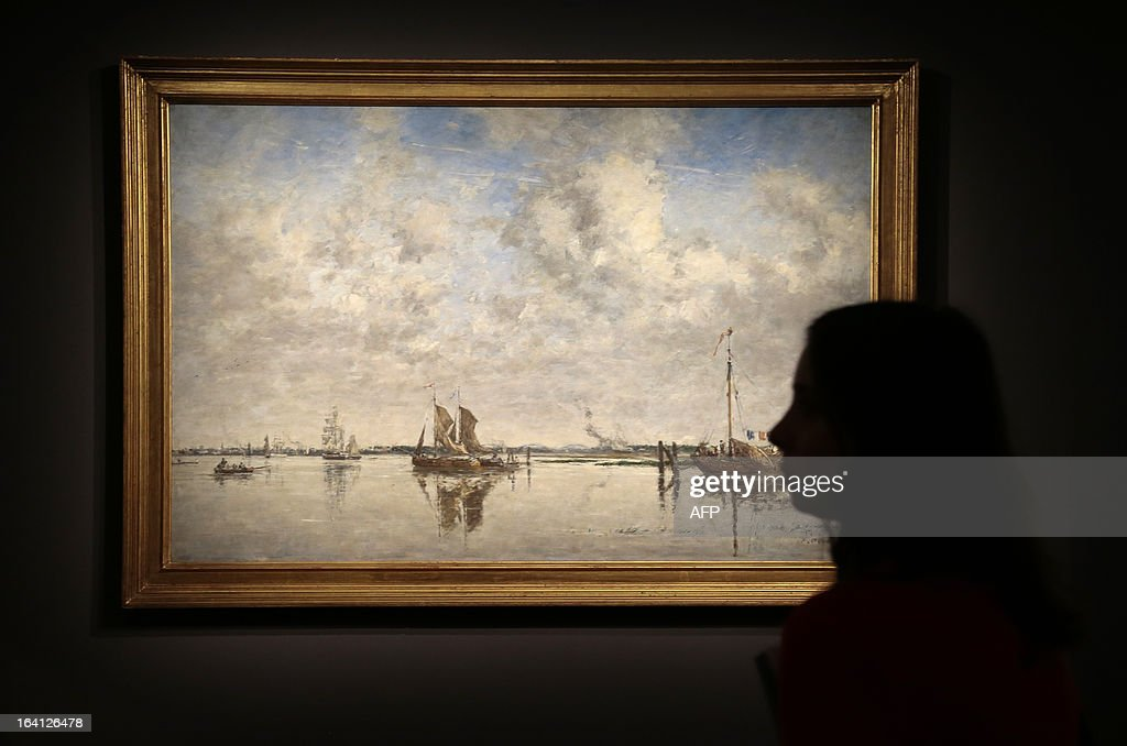 A visitor looks at the painting, 'la Meuse a Rotterdam', on March 20, 2013 at the Jacquemart-Andre museum during the inaugural visit to the French painter Eugene Boudin's (1824 - 1898) exhibition running from March 22 to July 22, 2013. AFP PHOTO/JACQUES DEMARTHON