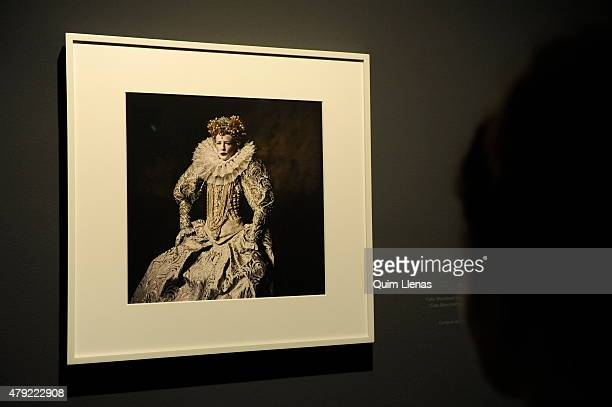A visitor looks at the photograph titled 'Cate Blanchett as Queen Elizabeth I New York' by Irving Penn during the opening for the press of 'Vogue...