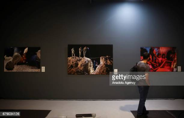 A visitor looks at the photos of Australian Photo Journalist Daniel Berehulak who works for The New York Times winner of the 'Third Prize' in the...