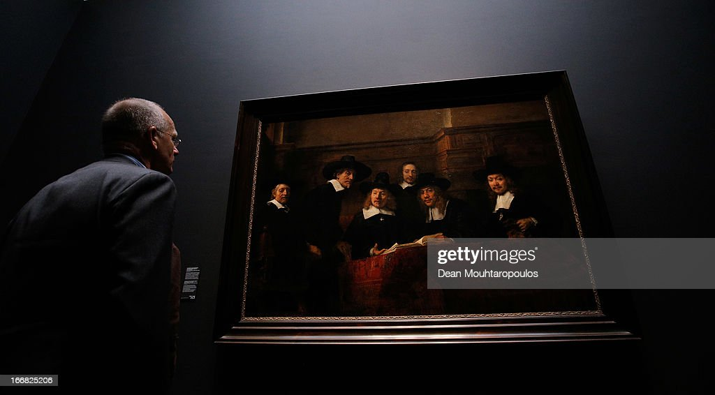 A visitor looks at The Sampling Officials (Dutch: De Staalmeesters), also called Syndics of the Drapers' Guild, is a 1662 oil painting by Rembrandt four days after the Rijksmuseum Official Opening on April 17, 2013 in Amsterdam, Netherlands. The 10-year renovation of the Rijksmuseum is one of the most significant ever undertaken by a museum. The entire building has been renewed – the historic 19th-century building has been transformed and new public facilities have been created including a spectacular new entrance hall, a new Asian pavilion and renovated gardens. The museum features over 8,000 works of art and artefacts telling the story of 800 years of Dutch art and history, from the Middle Ages to the present day. The world-famous collection, including masterpieces by artists such as Frans Hals, Jan Steen, Johannes Vermeer and Rembrandt van Rijn, have been presented in chronological sequence for the first time, creating an awareness of time and a sense of beauty.