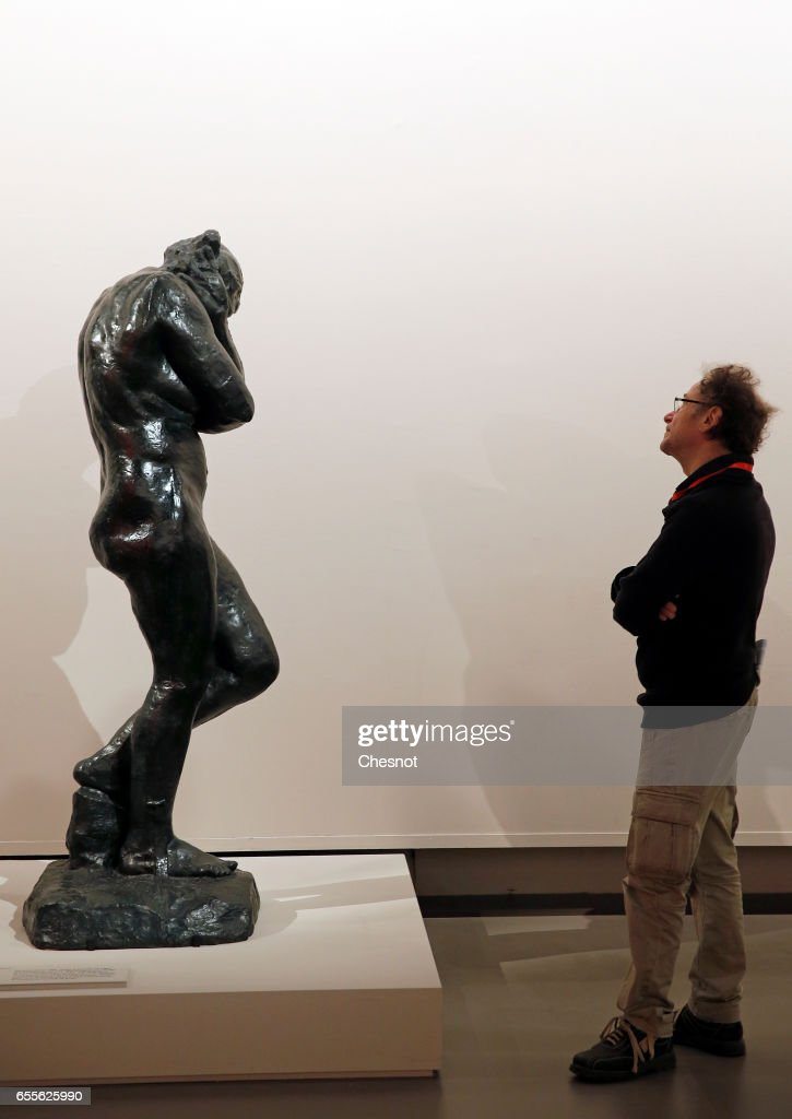 A visitor looks at the sculpture 'Eve, 1881' by French sculptor Auguste Rodin (1840-1917) during the press preview 'Rodin the centennial exhibition' at the Grand-Palais on March 20, 2017 in Paris, France. To mark the centenary of his death, the Rodin museum and the Grand-Palais are joining forces to celebrate Auguste Rodin (1840-1917). This exhibition takes part from March 22 to July 31, 2017.