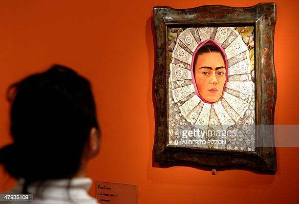 A visitor looks at the 'SelfPortrait' painting by Mexican artist Frida Kahlo during an exhibition in Rome's Scuderie del Quirinale on March 18 2014...