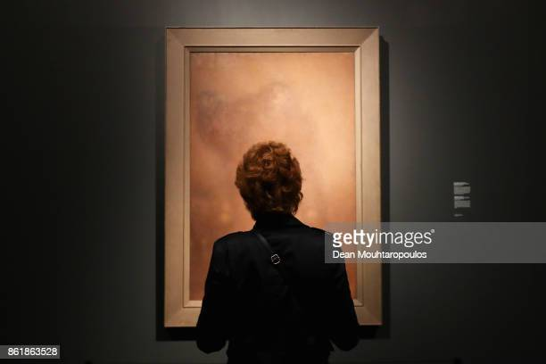 A visitor looks at The Shepherdess or the Monumental Conception of Humanity by Matthijs Maris during a special exhibition held at the Rijksmuseum...