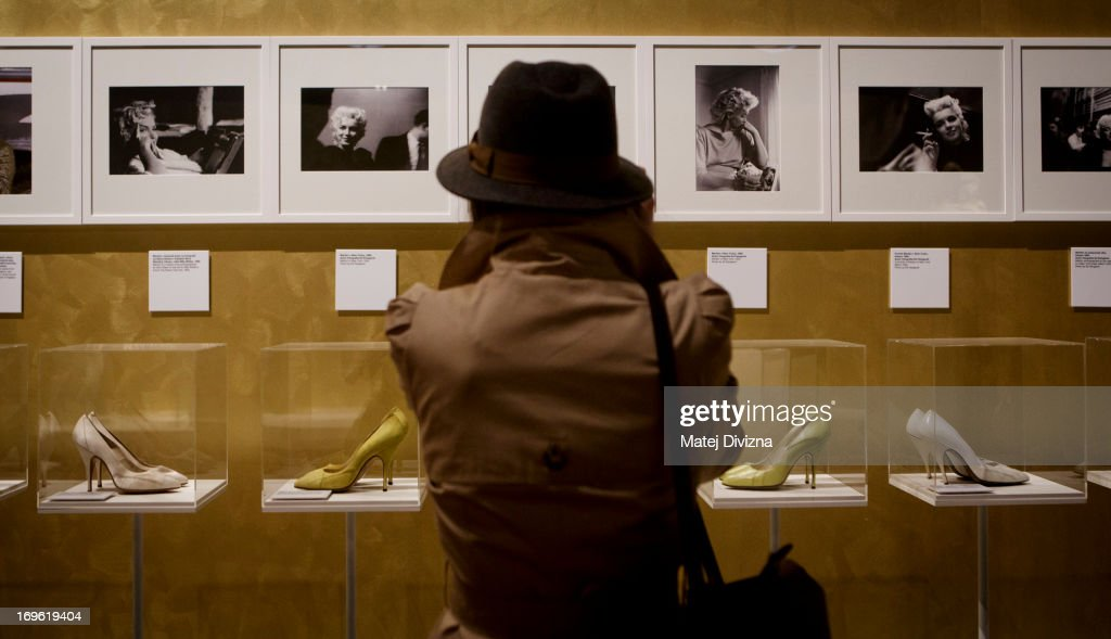 A visitor looks at the shoe collection during a press preview of the 'Marilyn' exhibition at Prague Castle on May 29, 2013 in Prague, Czech Republic. The exhibition was created by the Museo Salvatore Ferragamo in Florence, in 2012. Marilyn Monroe loved and owned many pairs of shoes made by Ferragamo. The Marilyn exhibition, which commemorates the 50th anniversary of her death, runs at the Riding School until September 20, 2013. The exhibition will present 30 pairs of shoes and over 50 outfits and other accessories from Marylin's personal, public and movie wardrobe and also historical movie clips, magazine covers and Marilyn's original writings.