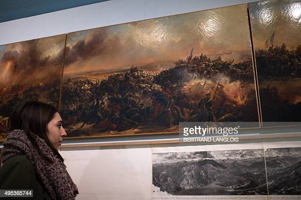 A visitor looks at the work 'Maquette du Panorama de la prise de Sebastopol' by French artist JeanCharles Langlois as part of the exhibition 'J'aime...