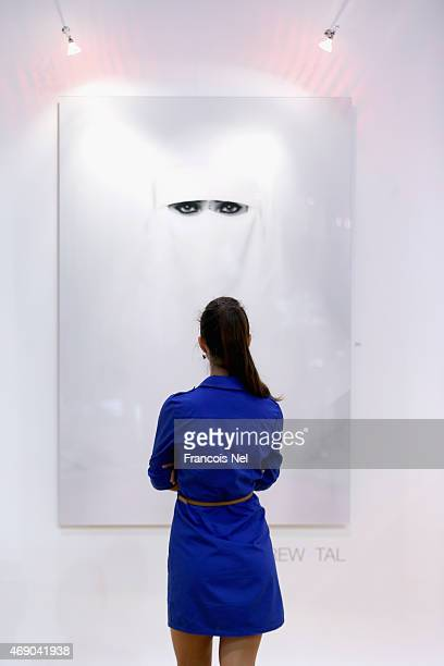A visitor looks at the work of artist Drew Tall during World Art Dubai 2015 at Dubai World Trade Centre on April 9 2015 in Dubai United Arab Emirates