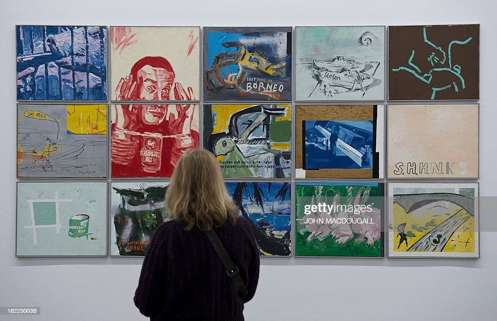 A visitor looks at the work 'The Torture of Alcohol' (from the 15-part series 'from the simplest to home') from 1981-82 by German artist Martin Kippenberger (1953-1997), on display at the exhibition 'Martin Kippenberger Sehr Gut / Very Good' at Berlin's Hamburger Bahnhof museum for contemporary art on February 21, 2013. The exhibition, a retrospective of the artist's prolific and varied output opens from February 23 to August 18, 2013.