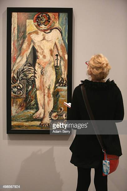 A visitor looks at the work 'Untitled ' circa 19381941 by Jackson Pollock during a press preview of the 'Jackson Pollock's Mural Energy Made Visible'...