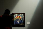 A visitor looks at Umberto Boccioni's painting 'Modern Idol ' on show at the opening of a new exhibition on futurism at the Scuderie del Quirinale in...