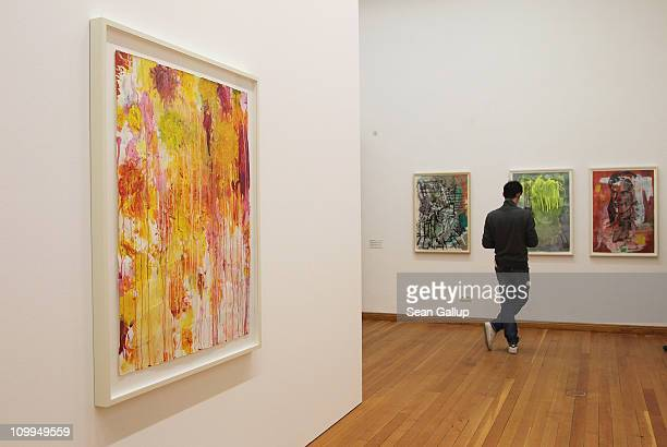 A visitor looks at works by Sigmar Polke as an untitled work by Cy Twombly hangs nearby on the opening day of the exhibition 'Kompass Drawings from...