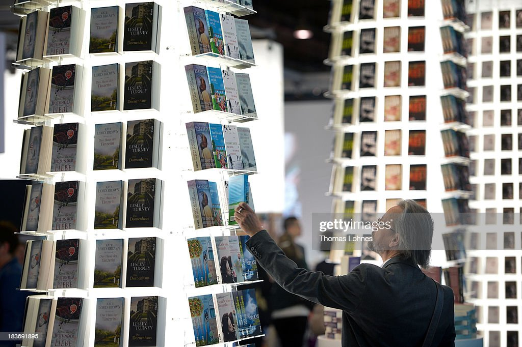A Visitor looks for a book at the 2013 Frankfurt Book Fair on October 9, 2013 in Frankfurt, Germany. This year's fair will be open to the public from October 9-13 and the official partner nation is Brazil.