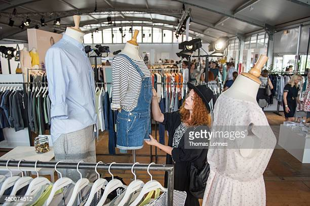 A visitor looks for new fashion at Ethical Fashion Show Berlin on July 8 2015 in Berlin Germany Bigger than ever 160 international labels are...