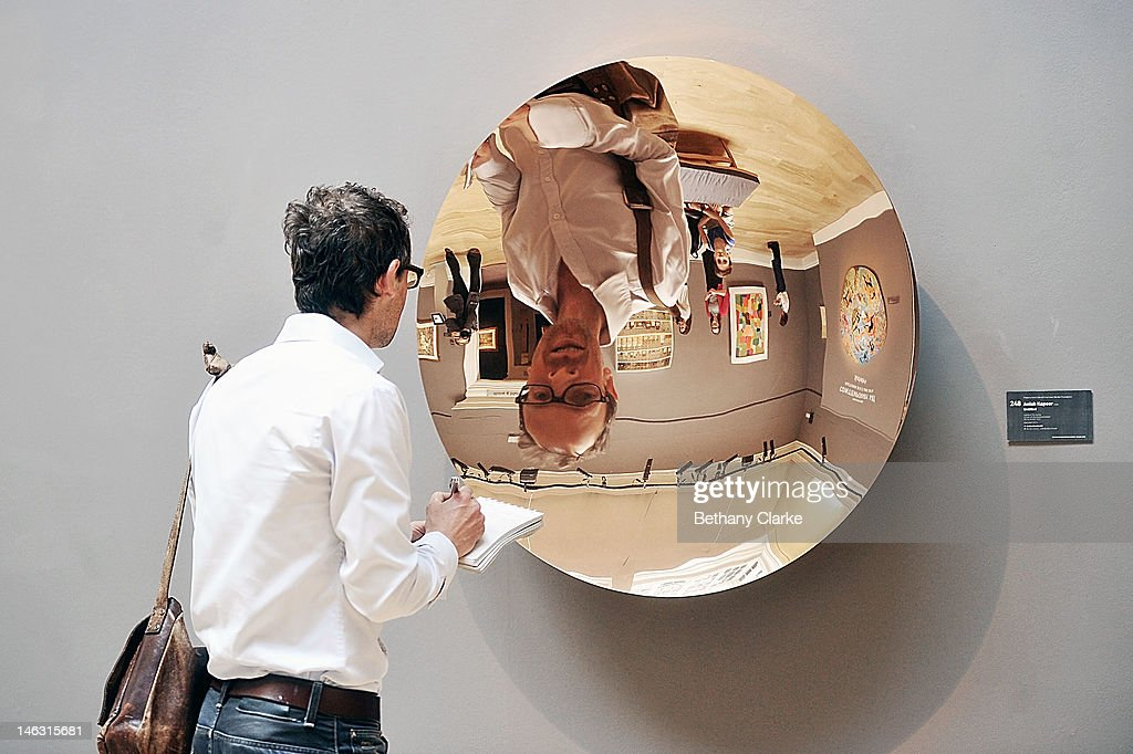 A visitor looks into 'Untitled' by Anish Kapoor on June 14, 2012 in London, England. This piece is part of the Impressionist & Modern and Contemporary Art sale at Sotheby's which will be held on June 19, 2012 and June 20, 2012.