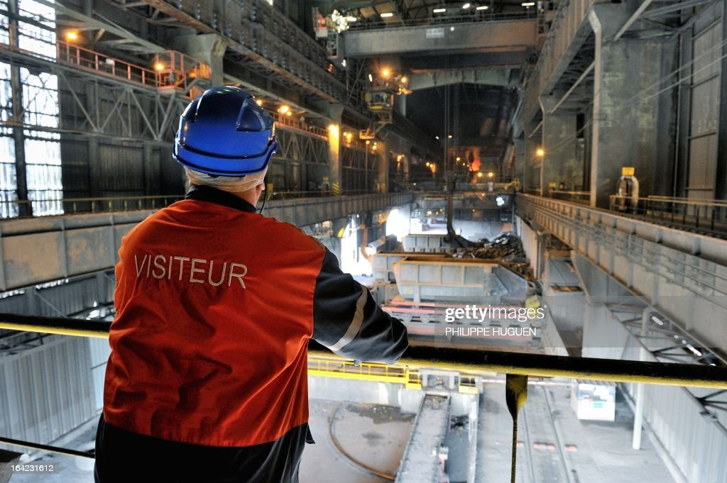 A visitor looks on during a guided tour at the Arcelor Mittal steel plant on March 21, 2013 in Grande-Synthe, northern France, as part of the 3rd edition of the 'Semaine de l'Industrie' (Week for Industry). AFP PHOTO PHILIPPE HUGUEN