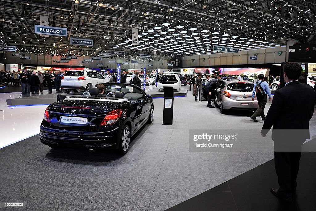 A visitor looks on during the 83rd Geneva Motor Show on March 6, 2013 in Geneva, Switzerland. Held annually with more than 130 product premiers from the auto industry unveiled this year, the Geneva Motor Show is one of the world's five most important auto shows.