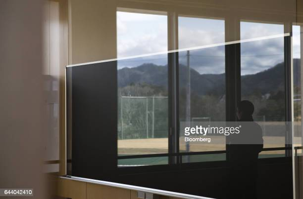 A visitor looks out of a window at the Narahamachi elementary school during preparations for the school's reopening in April in Naraha Fukushima...
