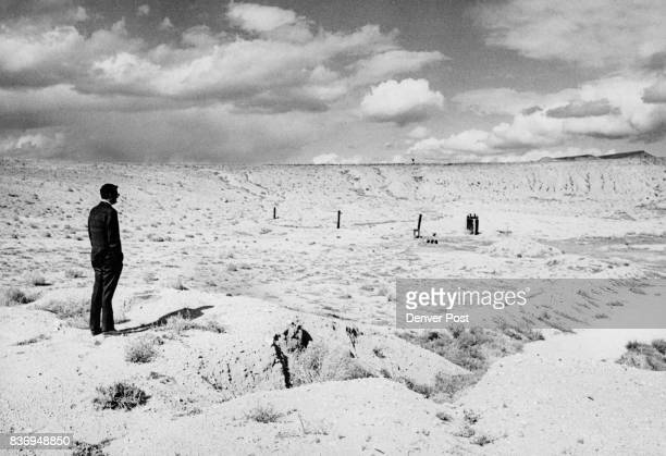 A visitor looks over a subsidence crater formed by the 200kiloton Project Bilby blast in 1963 Blast was felt in Las Vegas Nev 70 miles south Credit...
