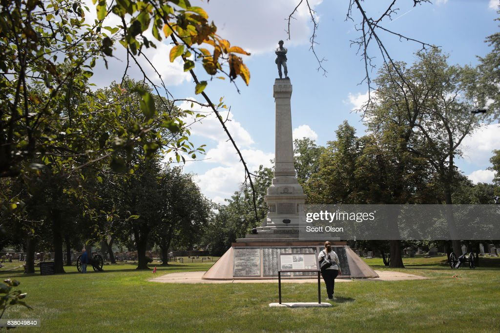 A visitor looks over Confederate Mound, a memorial to more than 4,000 Confederate prisoners of war who died in captivity at Camp Douglas and are buried around the monument on August 23, 2017 in Chicago, Illinois. The monument, which is maintained by the National Park Service, is located inside the private Oak Woods Cemetery on Chicago's Southside. Cities around the country are debating what to do with Confederate monuments following recent protests and calls for their removal.