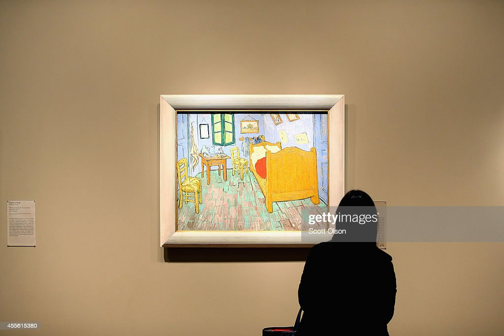 A visitor looks over Vincent van Gogh's The Bedroom at the Art Institute of Chicago on September 17 2014 in Chicago Illinois The museum which draws...
