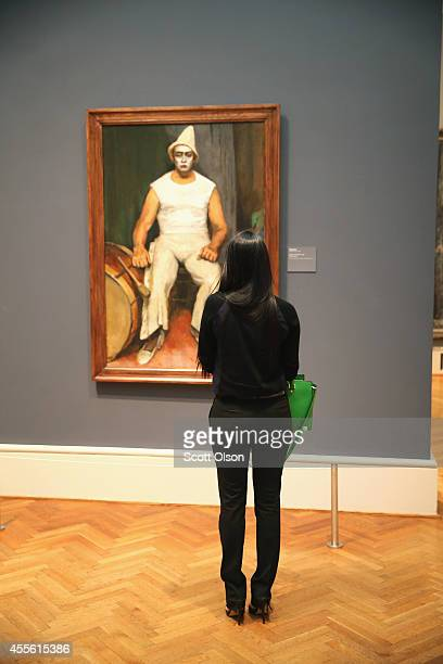 A visitor looks over Walt Kuhn's Clown with Drum at the Art Institute of Chicago on September 17 2014 in Chicago Illinois The museum which draws...