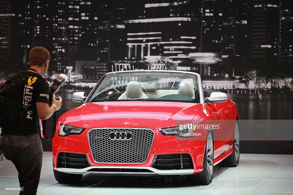 A visitor looks the Audi RS5 during the media preview at the Chicago Auto Show on February 7, 2013 in Chicago, Illinois. The Chicago Auto Show, one of the oldest and largest in the country, will be open to the public February 9-18.