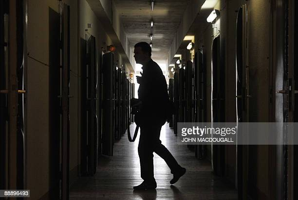 A visitor makes his way down a corridor leading to interrogation rooms in the former prison of the East German communistera secret police known as...