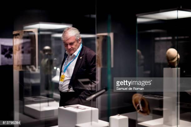 A visitor observes a sculpture during 'Agon La Competicion En La Antigua Grecia ' Art Exhibition at Caixaforum Madrid on July 13 2017 in Madrid Spain