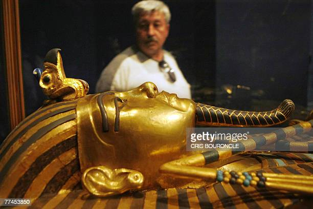 A visitor observes one of King Tutankhamun's gold sarcophagi at the Egyptian Museum in Cairo late 22 October 2007 This is the third and innermost...